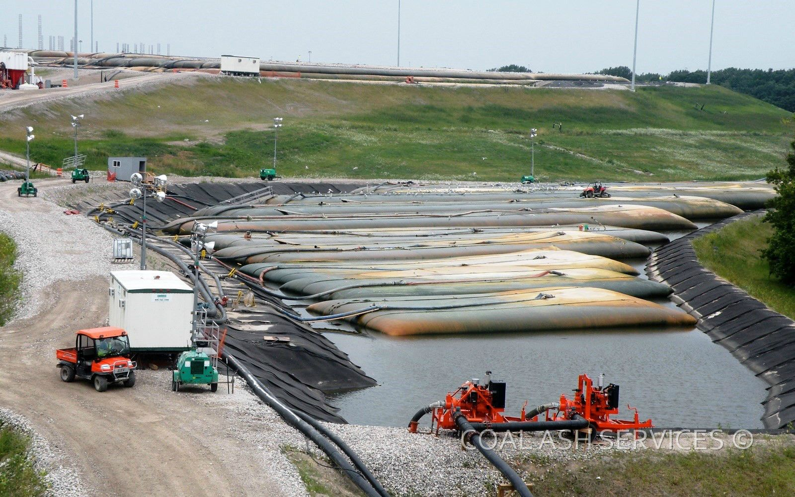 In-landfill geotextile tube dewatering