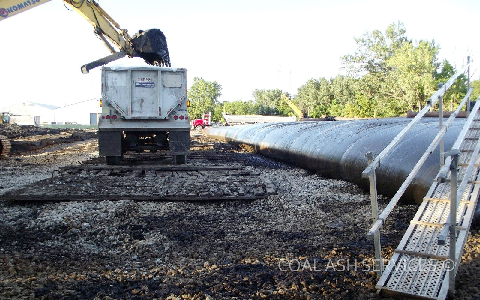 Rotational haul-out of geotextile tubes